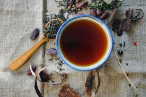 Cup of tea with herbs and spices
