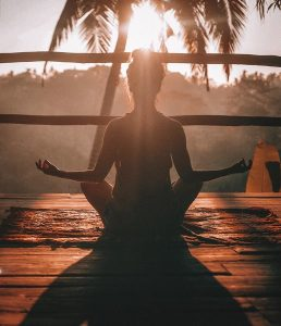 Woman meditating in the evening